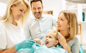 A Child together with his family in the Dentist